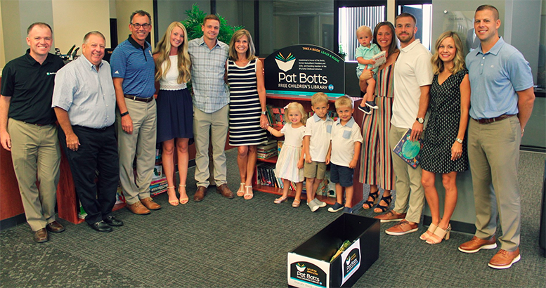 From left: Chris Cook, Dave Heeter and Chris Caldwell, representing Northwest, with Pat's family -- Taylor Botts, Adam Botts, Jane Botts, Molly Bucholtz, Sam Bucholtz, Jake Bucholtz, Archie Botts, Jordan Botts, Ben Botts, Erica Bucholtz and Jason Bucholtz -- gathered to dedicate the Pat Botts Free Children's Library.